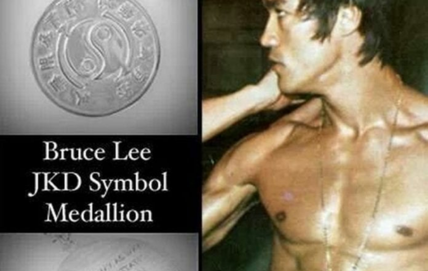 What's written on the other side of Bruce Lee's medallion